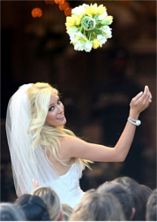 The Bride Of A Typical Modern Wedding Is Always Shown Throwing Her Bouquet Flowers Herbs Over Shoulder To Group Onlookers Eager Take It